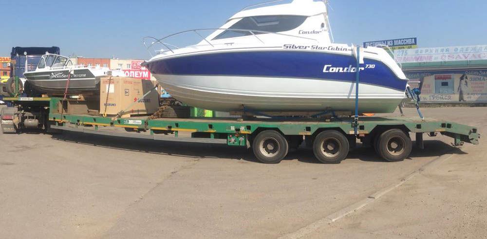 Процесс перевозки катера